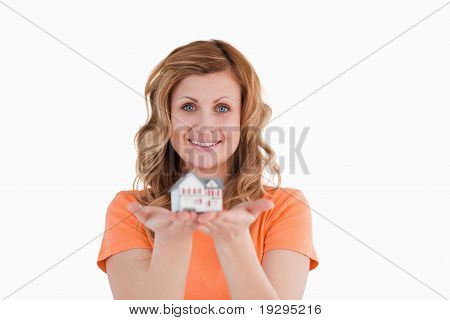 Woman holding an house model