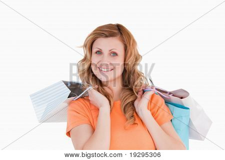 Blond-haired woman showing her shopping