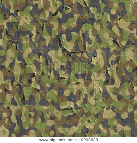 image of old flaking and peeling camouflage material