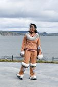 stock photo of chukotka  - Smiling chukchi woman in the folk clothes - JPG