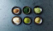 Assorted organic Super Foods. Siberian ginseng, chlorella, green barley, maca, green oat, kale powde poster