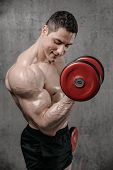 Brutal Strong Athletic Men Pumping Up Muscles poster