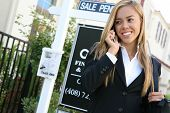 foto of clientele  - A beautiful young real estate agent woman on the phone - JPG