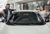 Couple At Car Dealership poster