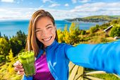 Healthy green smoothie juice drinking selfie girl taking picture clean food diet healthy nutrition.  poster