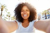 Selfie Of Laughing Black Woman Outside With Curly Hair poster