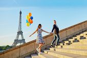 Couple With Colorful Balloons Near The Eiffel Tower poster
