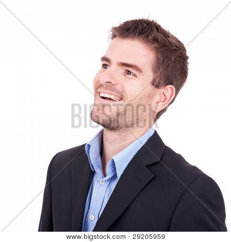 side view of a relaxed yound business man looking at something over white background