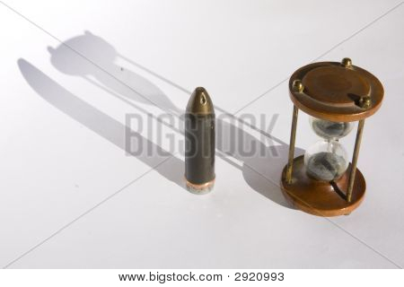 Sand-Glass And A Big Bullet (Killing Time Concept)