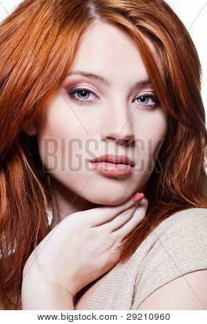 Closeup portrait of a sexy young woman with red hair and natural makeup