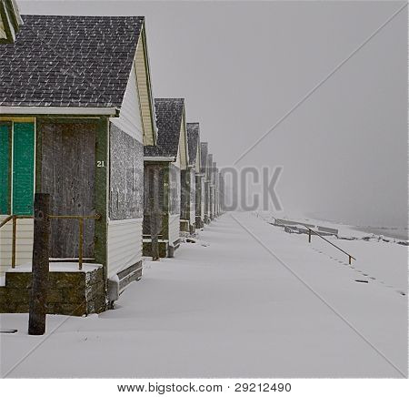 Days cottages in snow storm