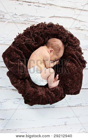 Cute newborn baby boy posing for camera