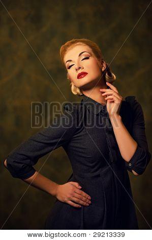 Retro woman in grey dress.