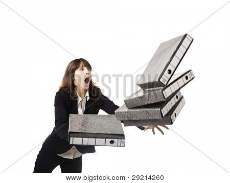 Woman in the office stumbling with a pile of folders in the hands, isolated on white