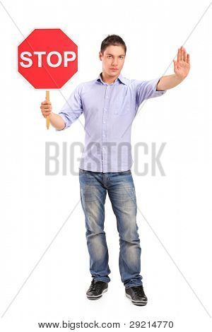 Full length portrait of a man gesturing and holding a traffic sign stop isolated against white background