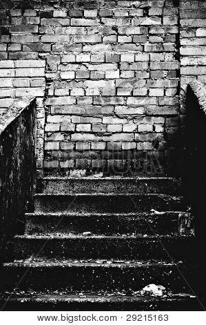 The Strange Staircase Leading Into Brick Wall. Black And White