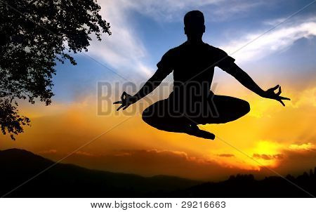 Yoga Silhouette Lotus Pose In Jumping