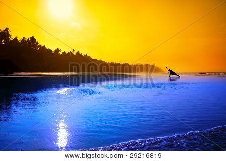 Yoga Utthita Parsvakonasana On The Beach