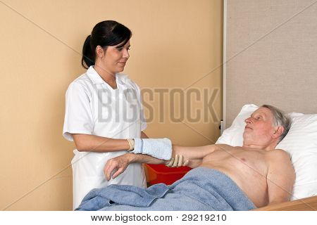 nurse washing a patient