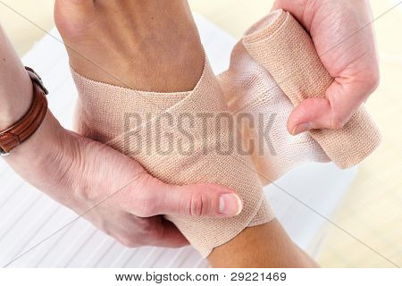Bandage and hurted leg. Health care.