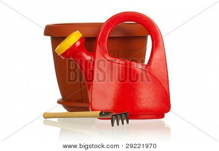Garden plastic pot, plastic red watering can and rake on a white background