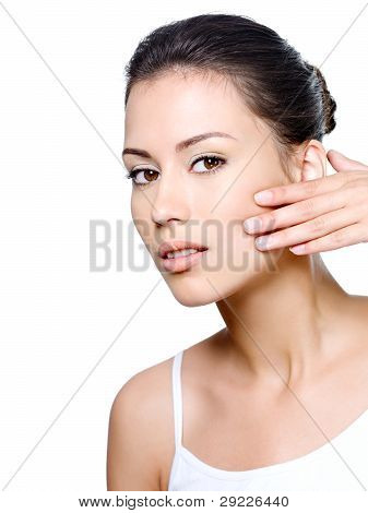 Woman Checking Existence Of Creases On Her Face