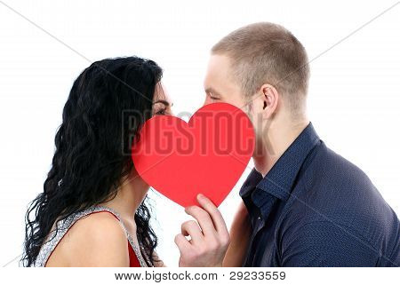 Happy couple behind a red heart