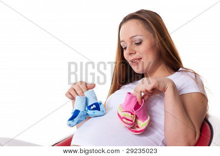 Pregnant Woman With Children's Bootees