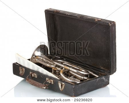 old trumpet in case and notebook with notes isolated on white