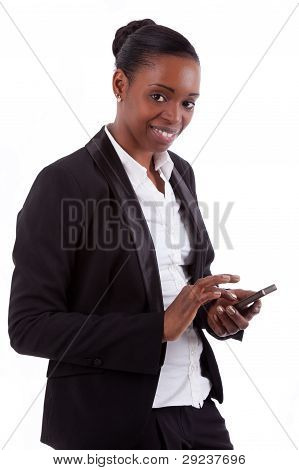 Smiling African American Businesswoman Using A Smartphone