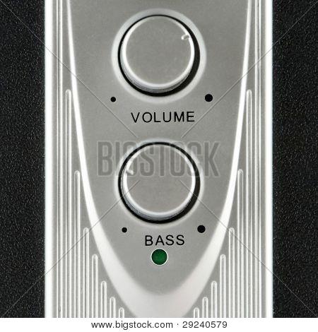 Volume and bass speaker controls closeup