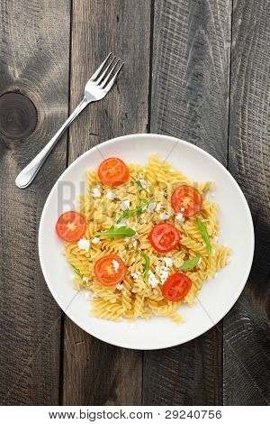 Plate Of Italian Pasta On Wooden Table