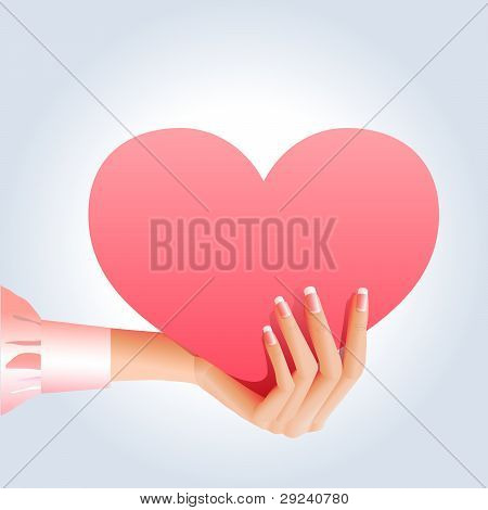 Female hand holds pinky heart