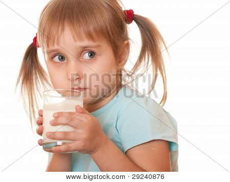 Thoughtful Girl Holding Glass Of Milk