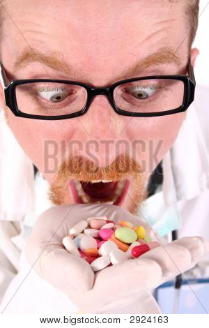 Doctor Taking Hand Full Of Tablets