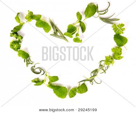 Fresh herbs in heart shape, isolated on white background