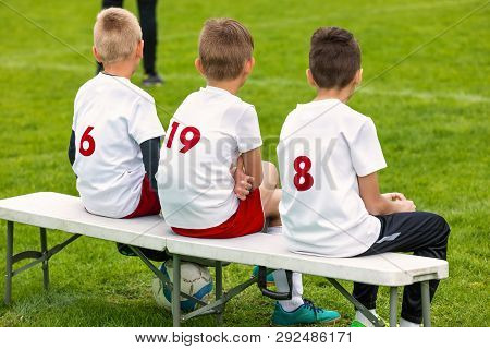 Boys Sitting On Soccer Football