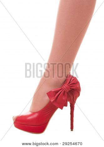 Sexy womanish red shoe isolated on white background.