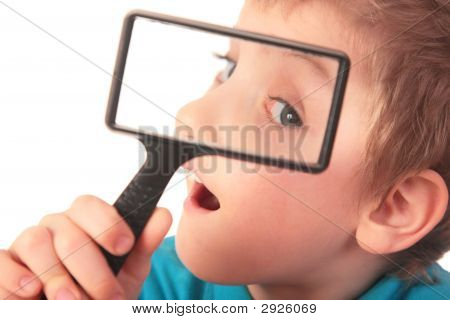 Boy Looks Through Magnifier With Interest