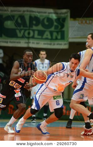 KAPOSVAR, HUNGARY - JANUARY 21: Kornel Kiss (white 6) in action at a Hungarian National Championship basketball game with Kaposvar (white) vs. Szolnok (black) on January 21, 2012 in Kaposvar, Hungary.