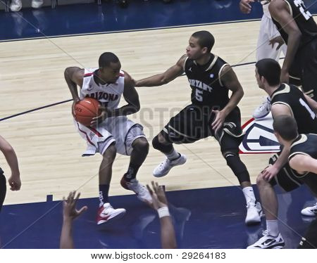 A Defensive Move By Arizona Wildcat Kyle Fogg