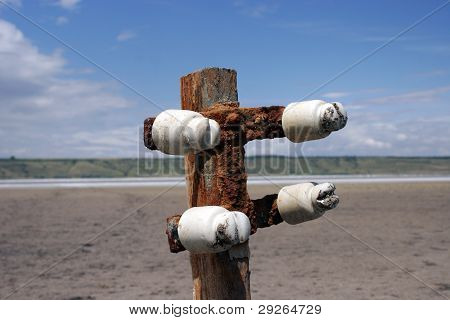Buried Old Wooden Electricity Pylons Close Up
