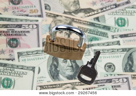 Many dollar bills with a lock. Security of the currency