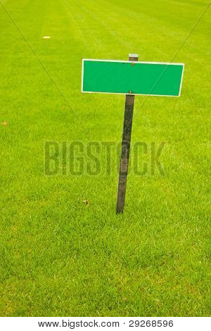 Green Grass With A Sign, Vertical Shot