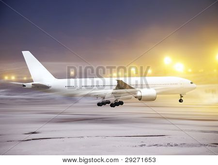 white plane in airport at non-flying weather, snow-storm