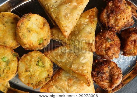 Indian buffet food with samosa, bhaji and pakora