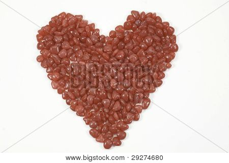 Red Candy In Heart Shape Isolated