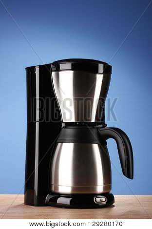 Coffee maker on blue background