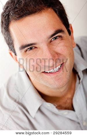 Handsome man portrait smiling - isolated over a white background