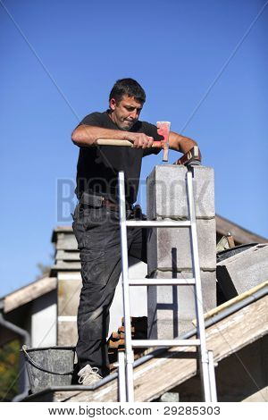 Builder constructing a chimney